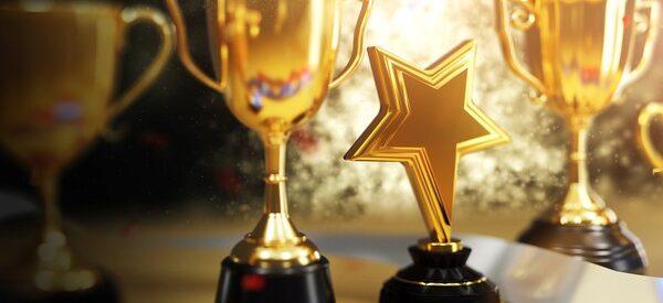 close-up-gold-trophy-award-3d-rendering_71582-222